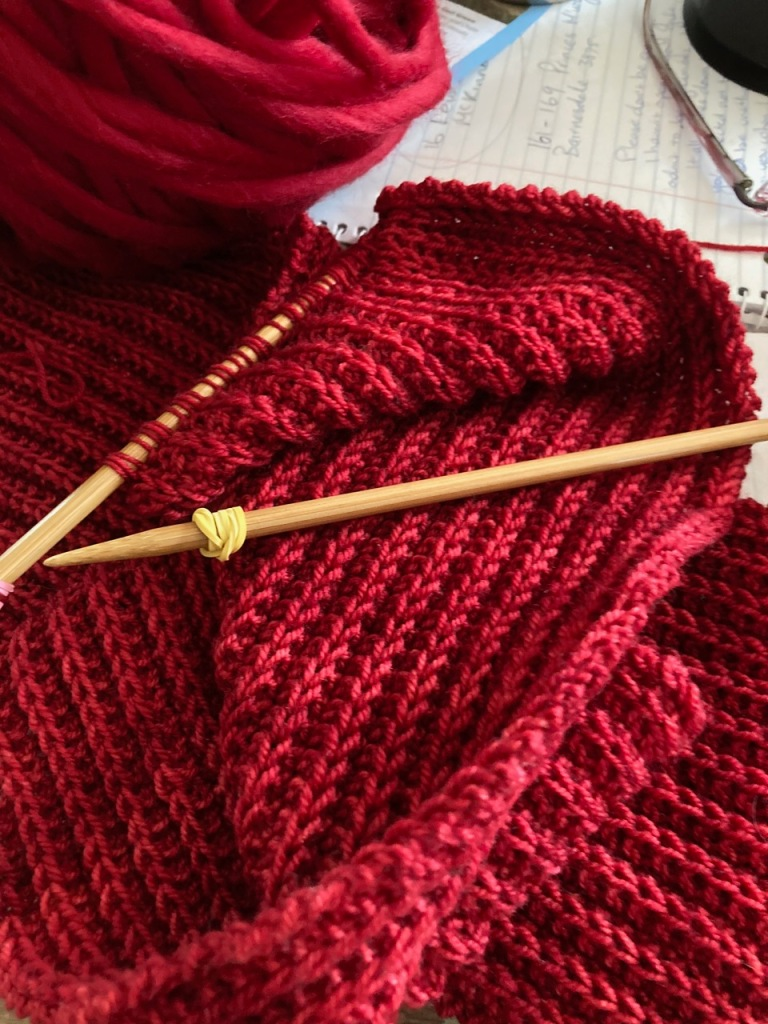 Bright red knitting.