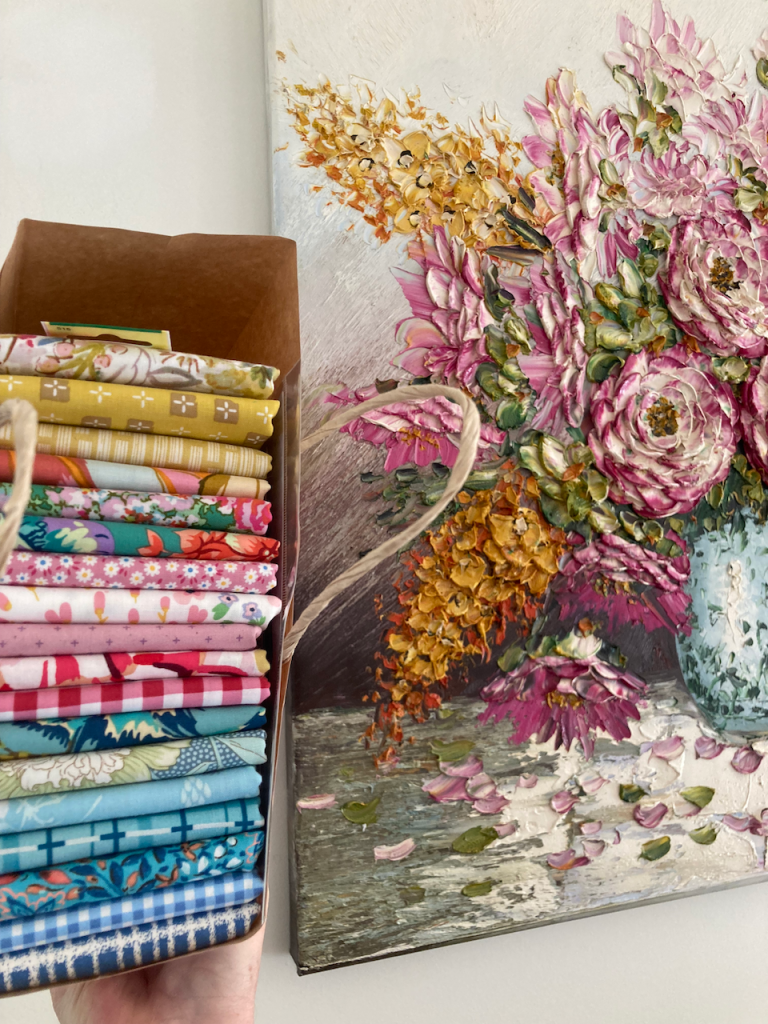 Fabric next to a painting.